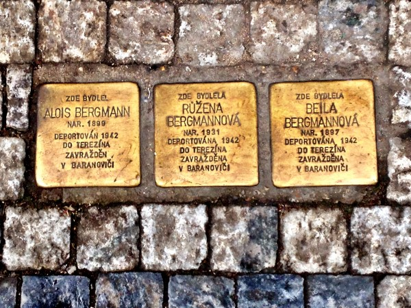 Commemorative street plaques of  Prague's Jewish Holocaust victims at their former residence - a father, mother and child
