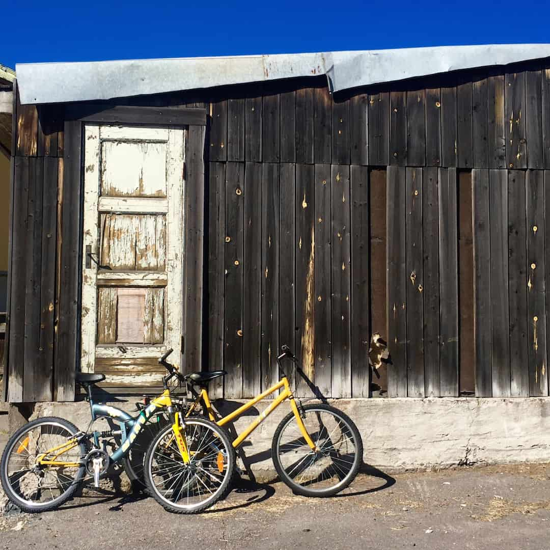 Bikes parked outside a modest building in old Kiruna