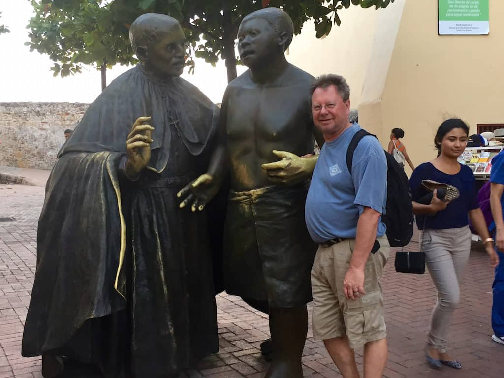 cartagena colombia tours - statue of san pedro claver and a slave