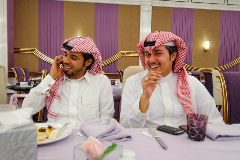 two saudi men at table